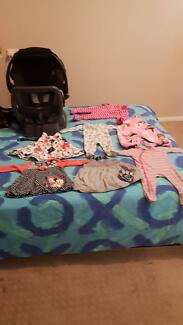 Baby clothing and a baby capsule
